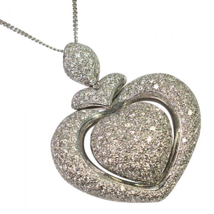 A contemporary design large heart shaped pendant set with brilliant cut diamonds weighing 3.5cts