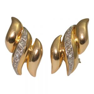 18ct gold earrings set with a row of rose cut diamonds which are set in platinum