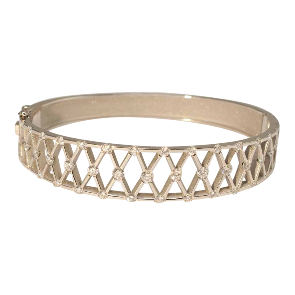 Diamond and Platinum bangle, with 'X' shaped lattice, incorporating diamonds at each corner. A lovely jewellery item available to buy online from Plaza Jewellery