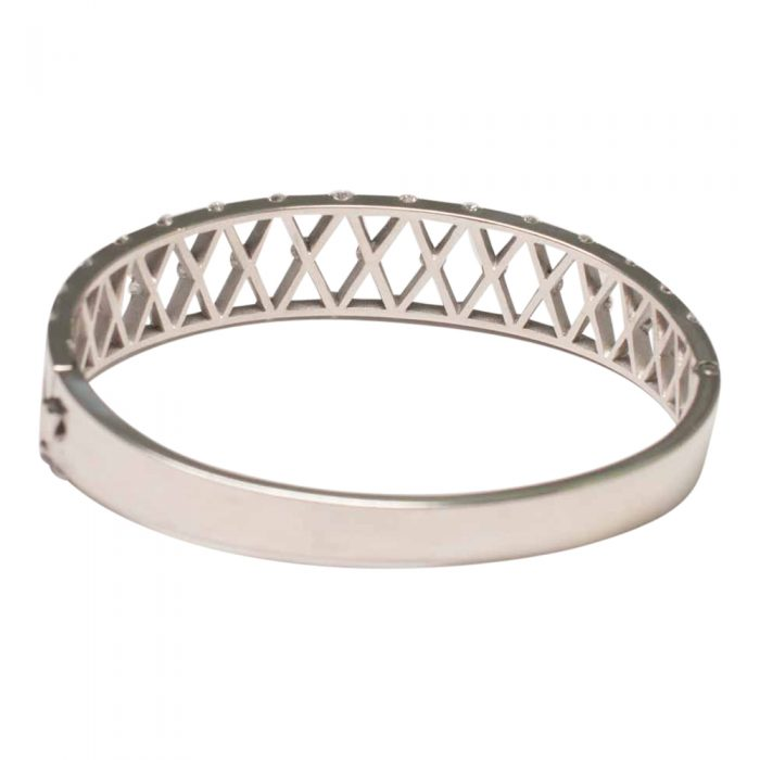 Rear view showing smooth side of Diamond and Platinum bangle, with 'X' shaped lattice, incorporating diamonds at each corner. A lovely jewellery item available to buy online from Plaza Jewellery