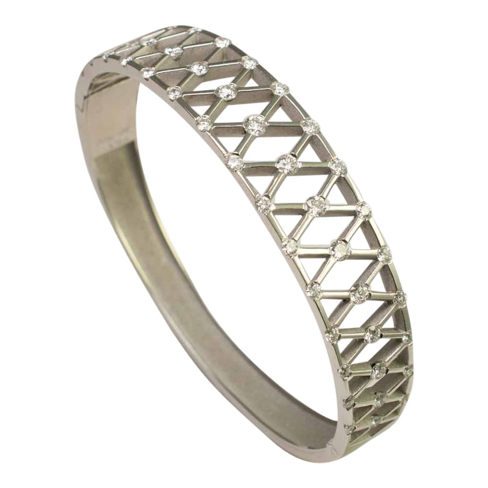 Angled view showing inside of Diamond and Platinum bangle, with 'X' shaped lattice, incorporating diamonds at each corner. A lovely jewellery item available to buy online from Plaza Jewellery