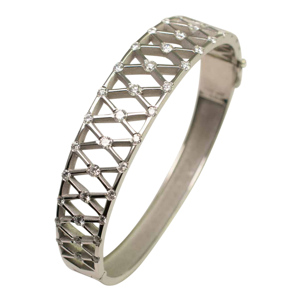 Angled view of Diamond and Platinum bangle, with 'X' shaped lattice, incorporating diamonds at each corner. A lovely jewellery item available to buy online from Plaza Jewellery