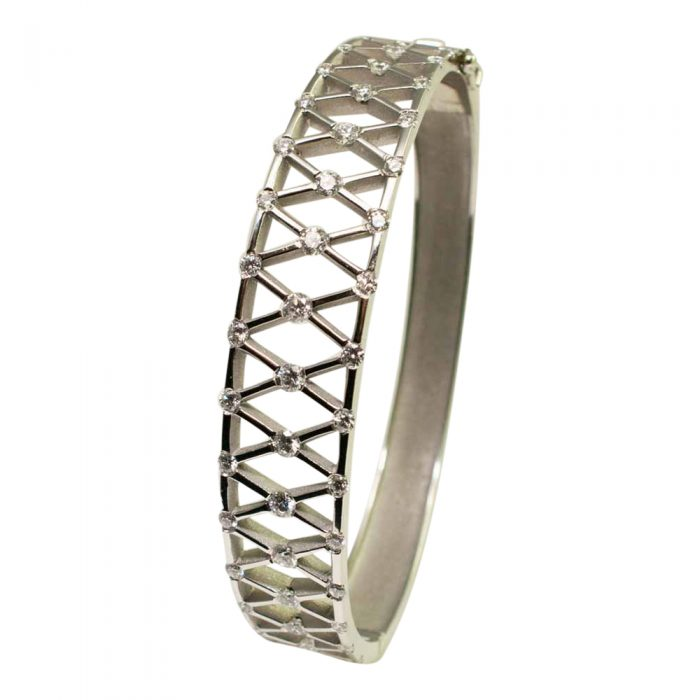 Vertical view of Diamond and Platinum bangle, with 'X' shaped lattice, incorporating diamonds at each corner. A lovely jewellery item available to buy online from Plaza Jewellery