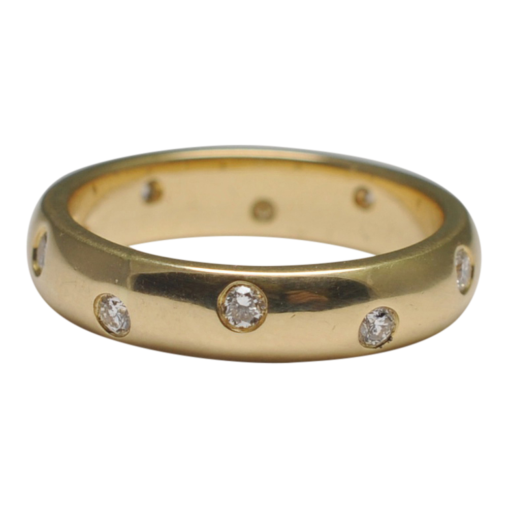 Tiffany style 18ct Gold and diamond wedding ring