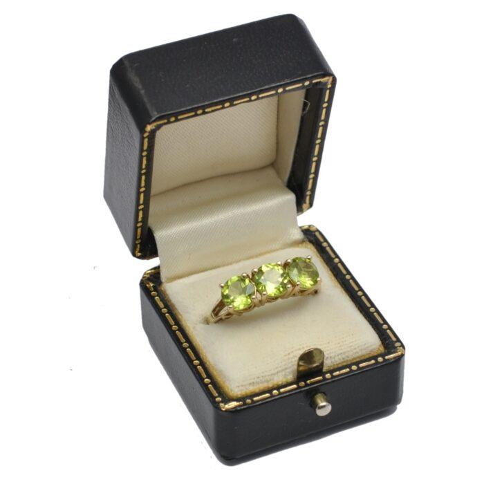 Peridot Trilogy Gold Ring
